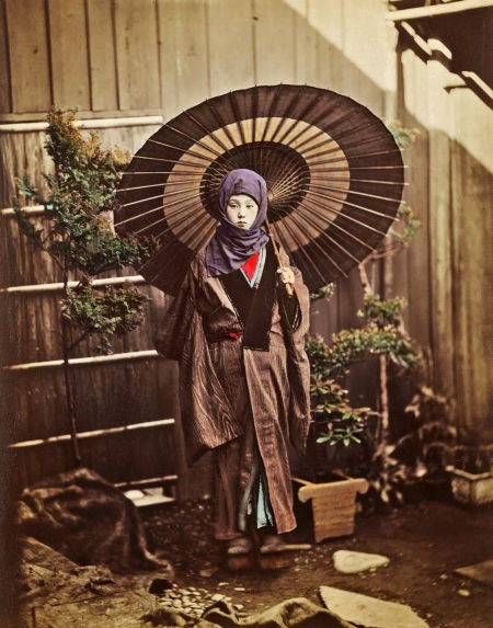 Japanese woman with parasol dressed for winter
